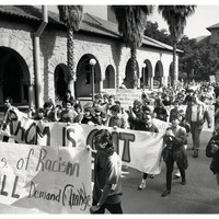 Students with banners protesting on Stanford campus