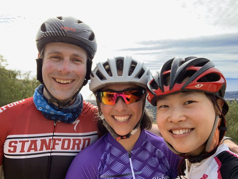 Recent Stanford graduates on a cycling trip wearing Stanford gear
