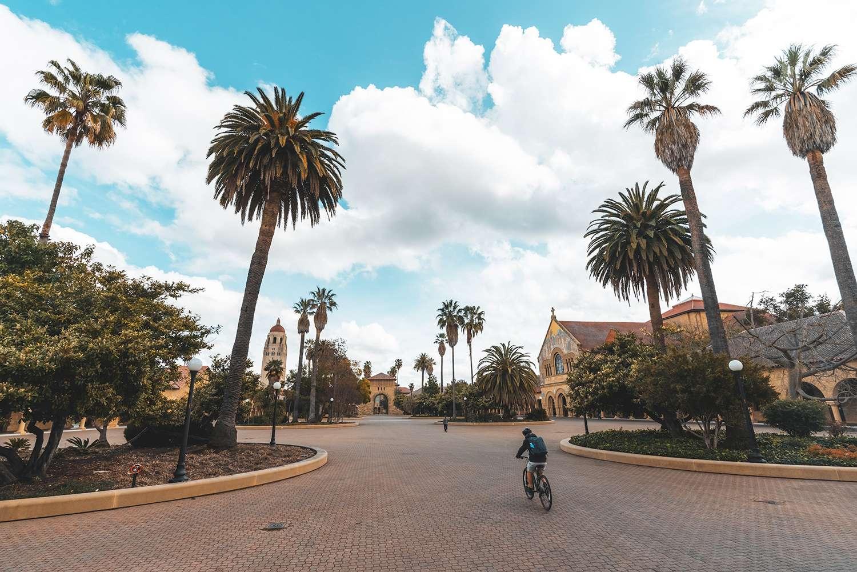 Student riding bike through Stanford campus