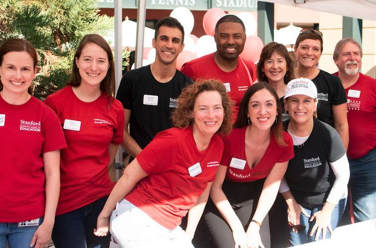 Office of development staff smile in red shirts